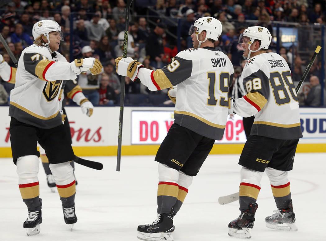 Vegas Golden Knights forward Reilly Smith, center, celebrates his goal against the Columbus Blu ...