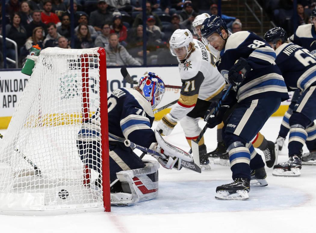 Vegas Golden Knights forward William Karlsson, center, of Sweden, watches forward Reilly Smith' ...