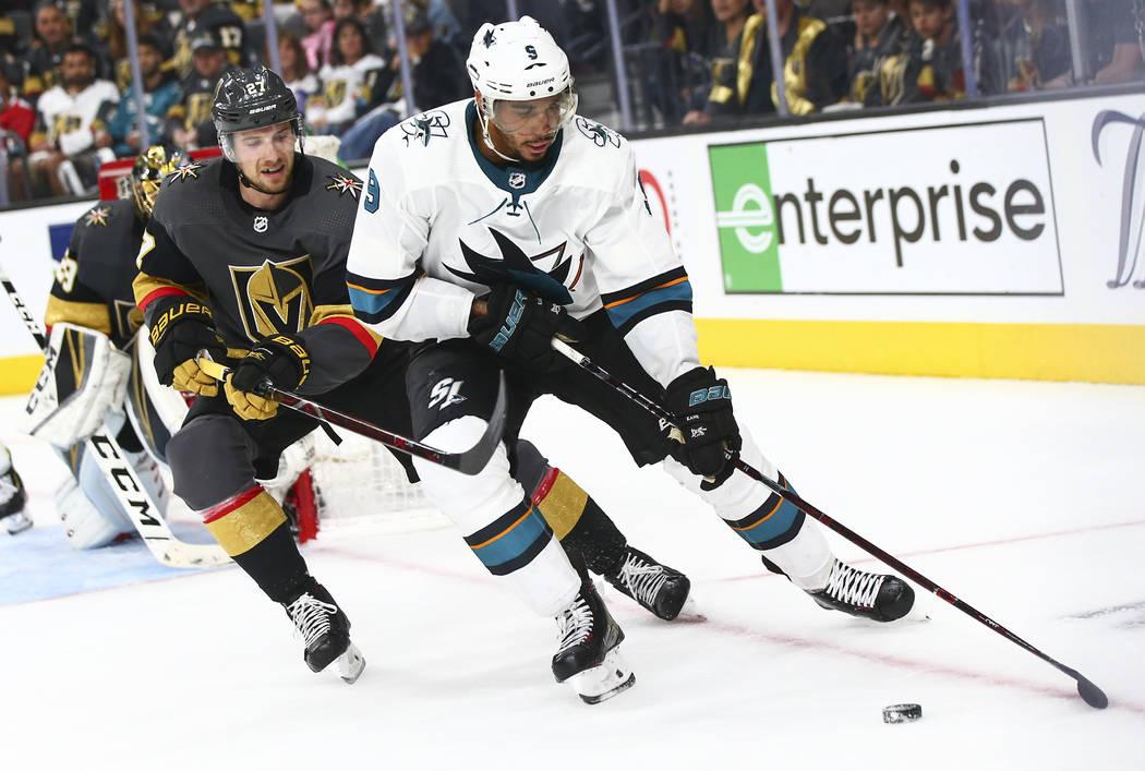 San Jose Sharks left wing Evander Kane (9) skates with the puck under pressure from Golden Knig ...