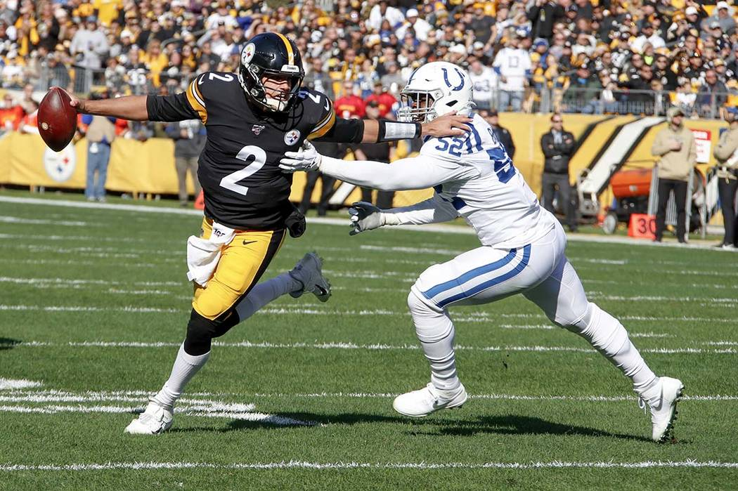Pittsburgh Steelers quarterback Mason Rudolph (2) scrambles away from Indianapolis Colts defens ...