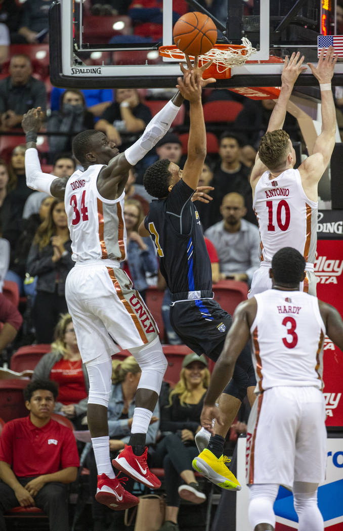 UNLV Rebels forward Cheikh Mbacke Diong (34, left) rejects a shot by Purdue Fort Wayne guard Ja ...