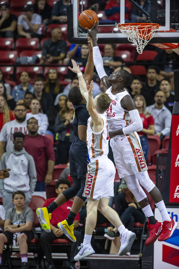 UNLV Rebels forward Cheikh Mbacke Diong (34, right) rejects a shot by Purdue Fort Wayne guard J ...
