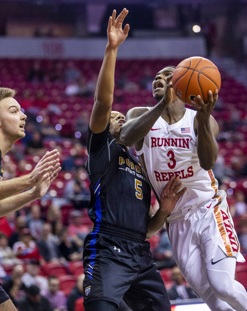 UNLV Rebels guard Amauri Hardy (3, right) elevates for a shot against Purdue Fort Wayne guard T ...