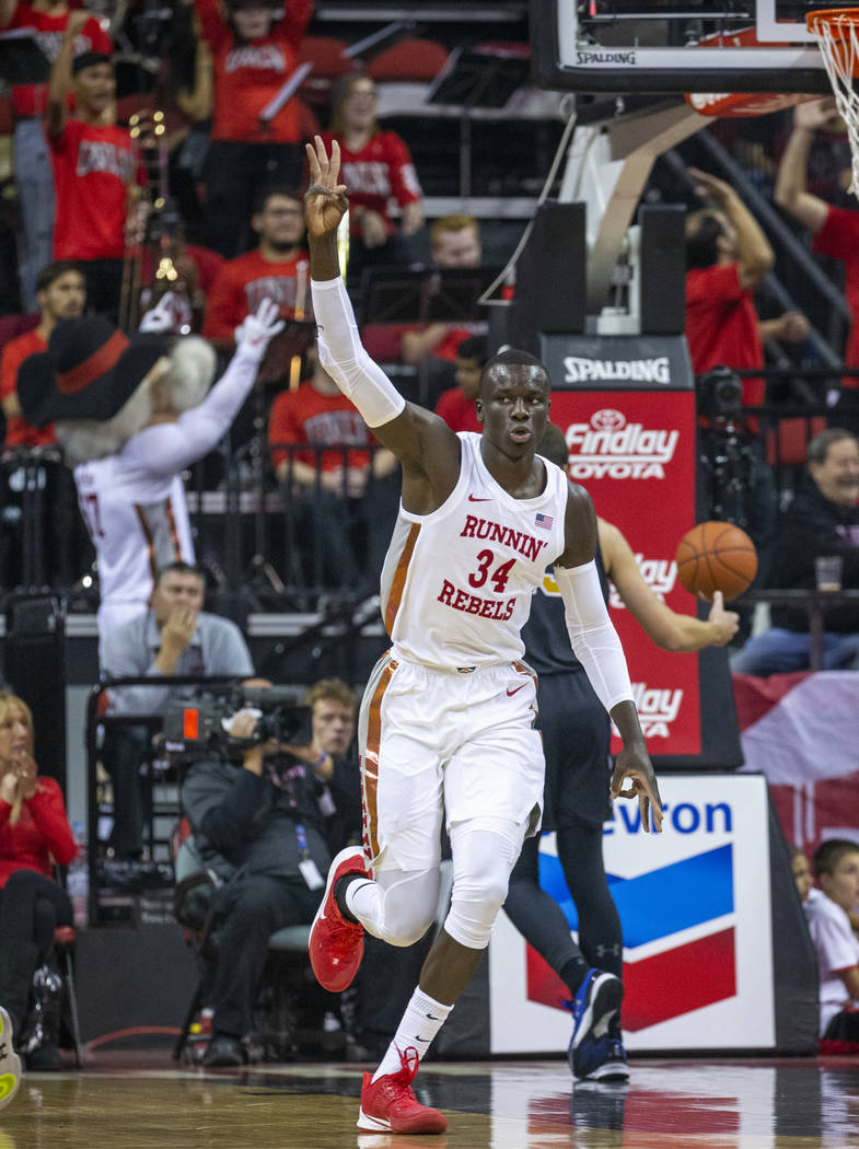 UNLV Rebels forward Cheikh Mbacke Diong (34) celebrates a dunk over Purdue Fort Wayne during th ...