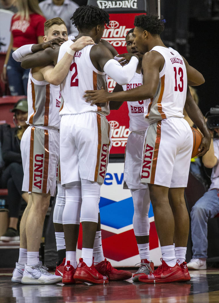 UNLV Rebels players huddle after a foul call versus Purdue Fort Wayne during the first half of ...