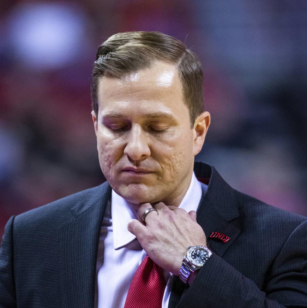UNLV Rebels head coach T.J. Otzelberger adjust his collar versus Purdue Fort Wayne during the s ...