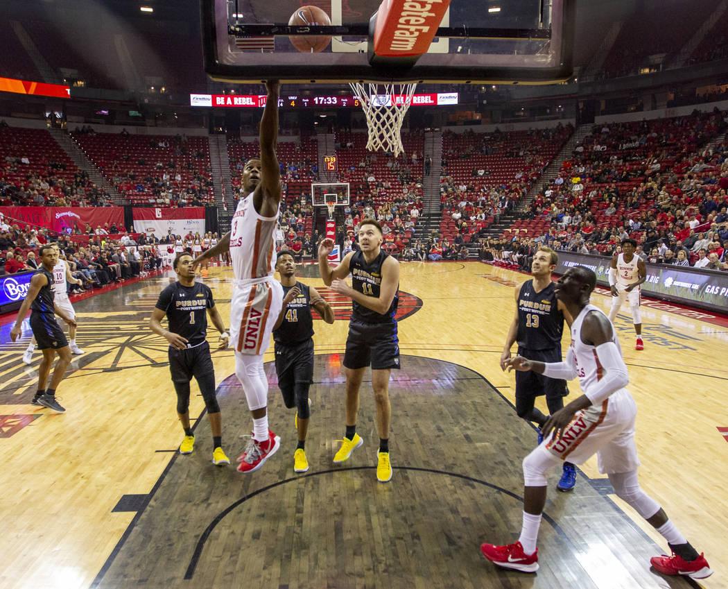 UNLV Rebels guard Amauri Hardy (3) slides between Purdue Fort Wayne defenders for a basket duri ...