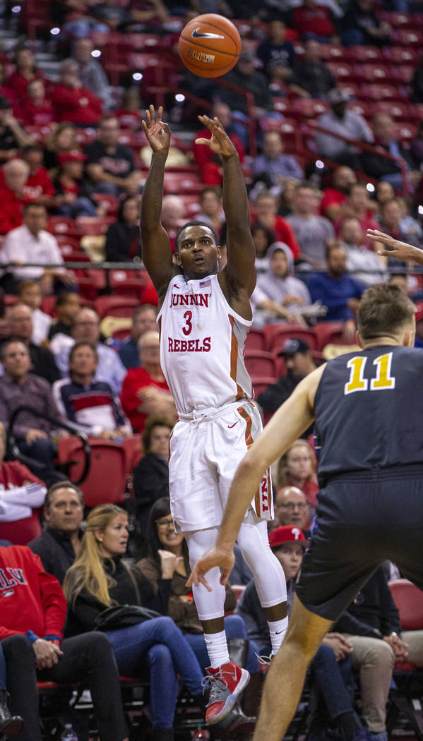 UNLV Rebels guard Amauri Hardy (3) elevates for a three-point basket over Purdue Fort Wayne for ...