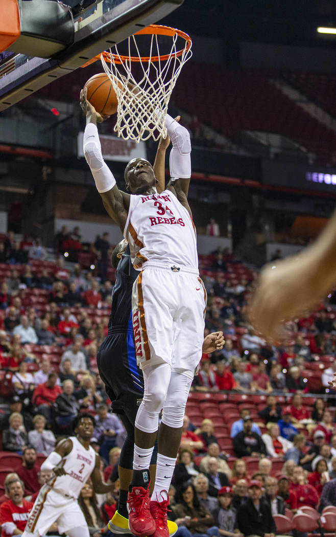 UNLV Rebels forward Cheikh Mbacke Diong (34) goes up for another dunk over Purdue Fort Wayne du ...