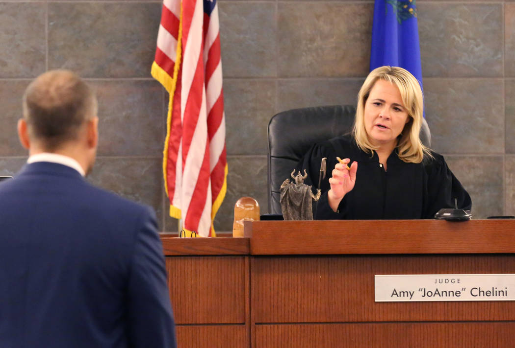 Attorney Ross Goodman, left, listens as Las Vegas Justice of the Peace Amy Chelini speaks durin ...