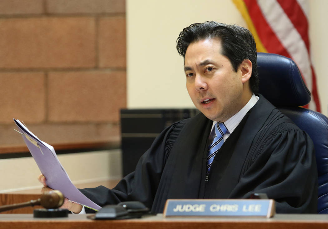 Justice of the Peace Chris Lee presides over a case in North Las Vegas Justice Court on May 21, ...
