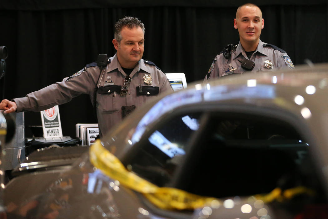 Nevada Highway Patrol spokesman Travis Smaka, left, and trooper Adam Whitmarsh, at the SEMA Sho ...