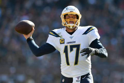Los Angeles Chargers quarterback Philip Rivers, center, throws a pass during the second half of ...