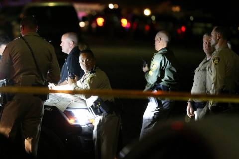 Las Vegas police officers respond Tuesday, Nov. 5, 2019, to a fatal shooting near Jones Bouleva ...