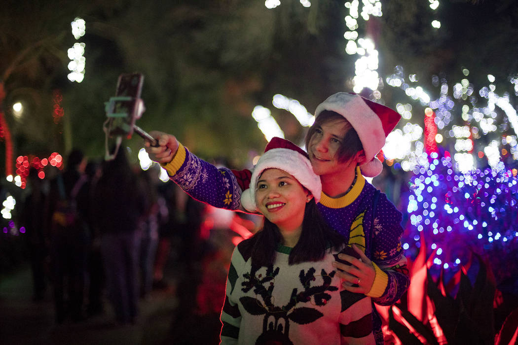 Dylan Rahilly takes a selfie with his wife, Heaven Magno, at the Ethel M Chocolates cactus gard ...