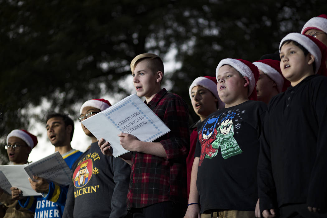 Members of the Coronado High School choir and the Schofield Middle School choir sing at the 26t ...