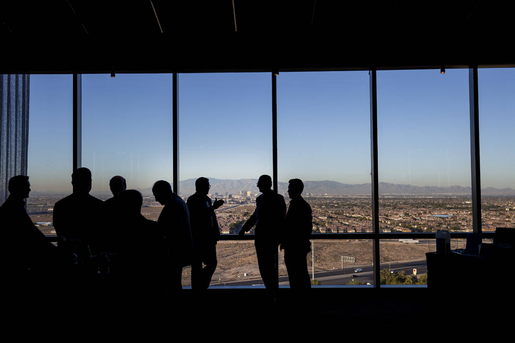 Individual mingle during the project overview for Bleutech Park Las Vegas, the proposed $7.5 bi ...