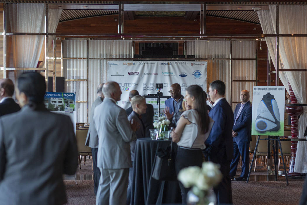 Individuals mingle during the project overview for Bleutech Park Las Vegas, the proposed $7.5 b ...