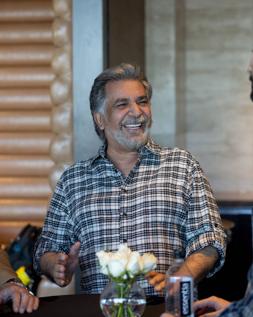 Khusrow Roohani, owner of Seven Valleys Realty & Construction, mingles during the project o ...