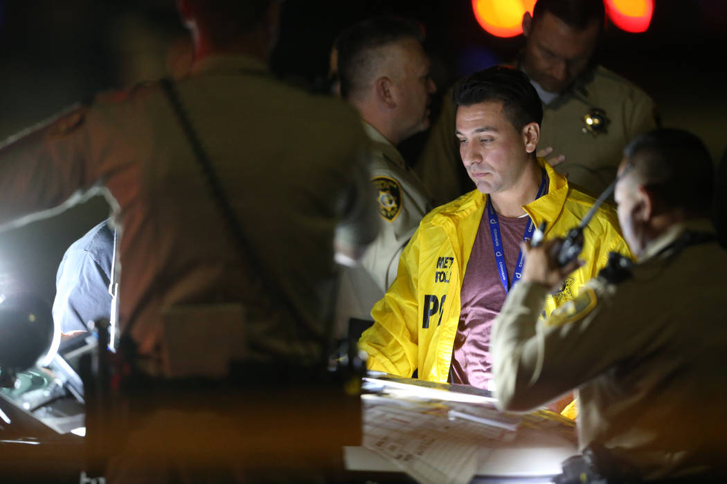 Las Vegas police officers responded to a fatal shooting at 6217 Burnt Hills Drive in Las Vegas, ...