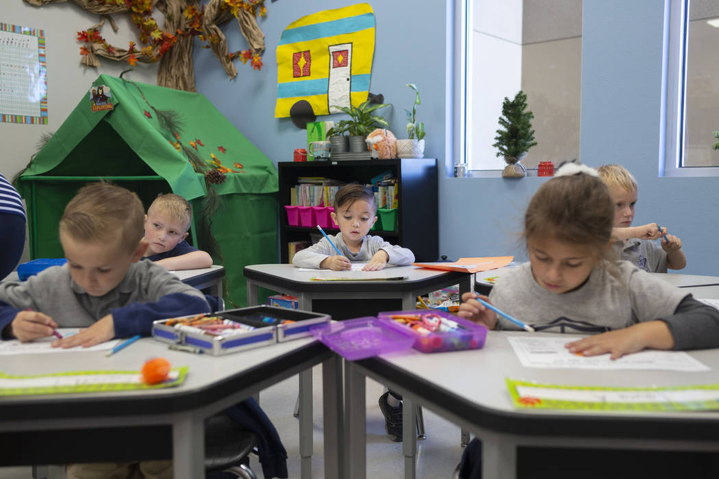 Kindergarten students work on a reading assignment at Pinecrest Academy, Nevada's newest campus ...
