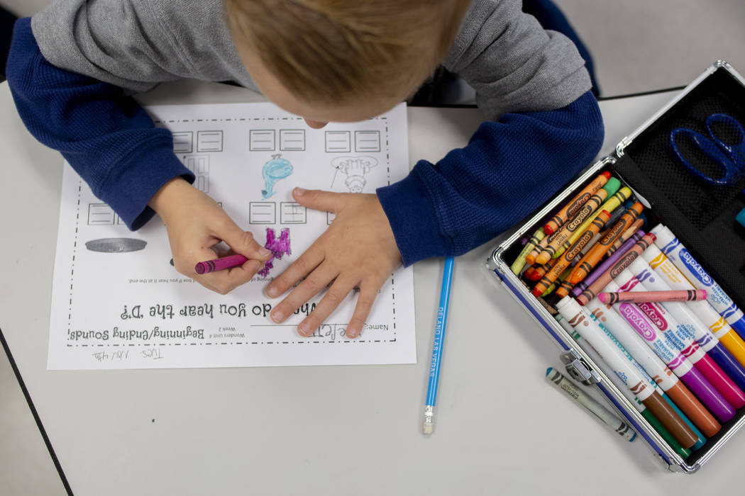 A kindergarten student works on a reading assignment at Pinecrest Academy, Nevada's newest camp ...