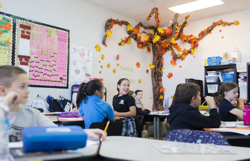 Third grade students participate in a reading exercise at Pinecrest Academy, Nevada's newest ca ...