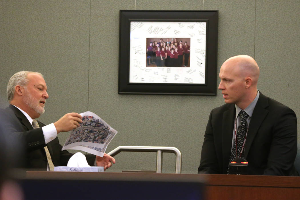Chief Deputy District Attorney Marc DiGiacomo, left, speaks to witness Las Vegas police officer ...