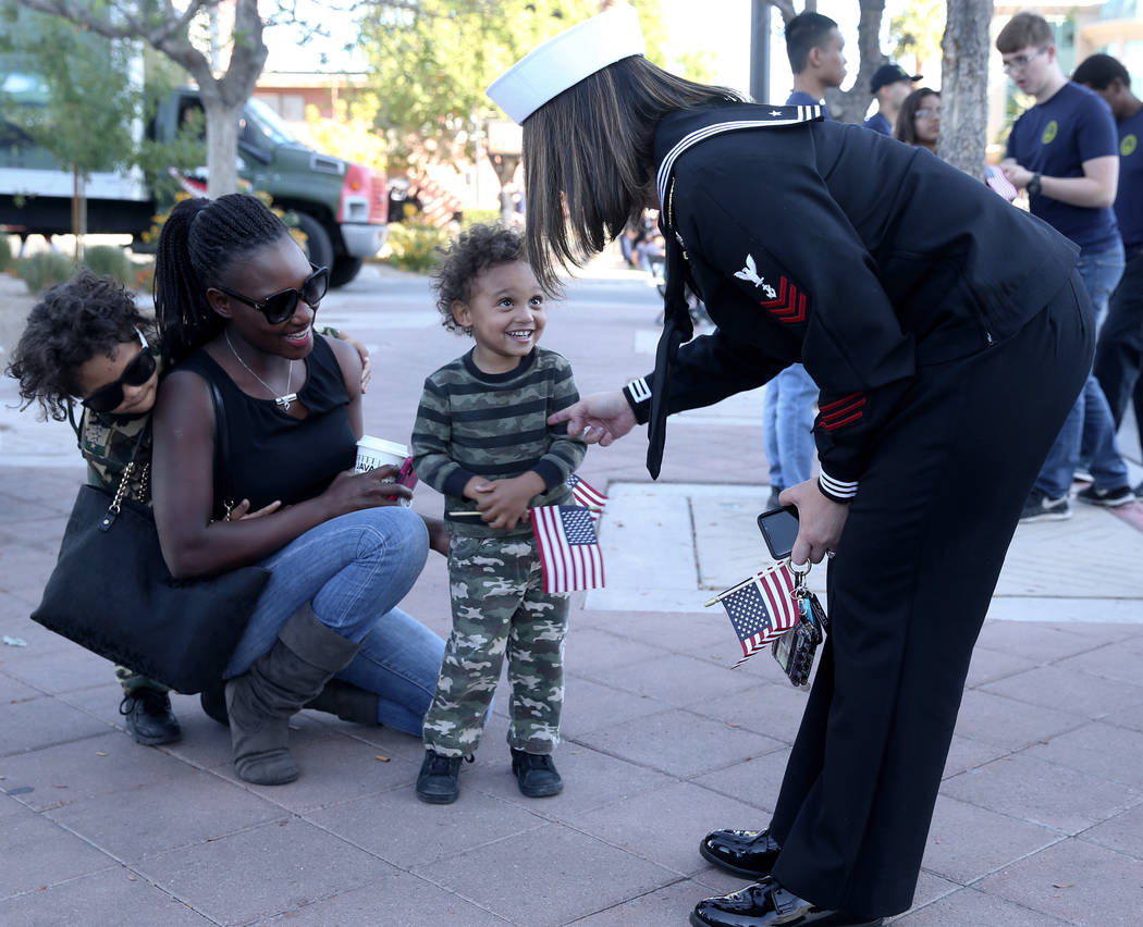 Chris Nelson, 3, greets Navy petty officer first class Ruth Dobson, 36, as his mother Susan Nel ...