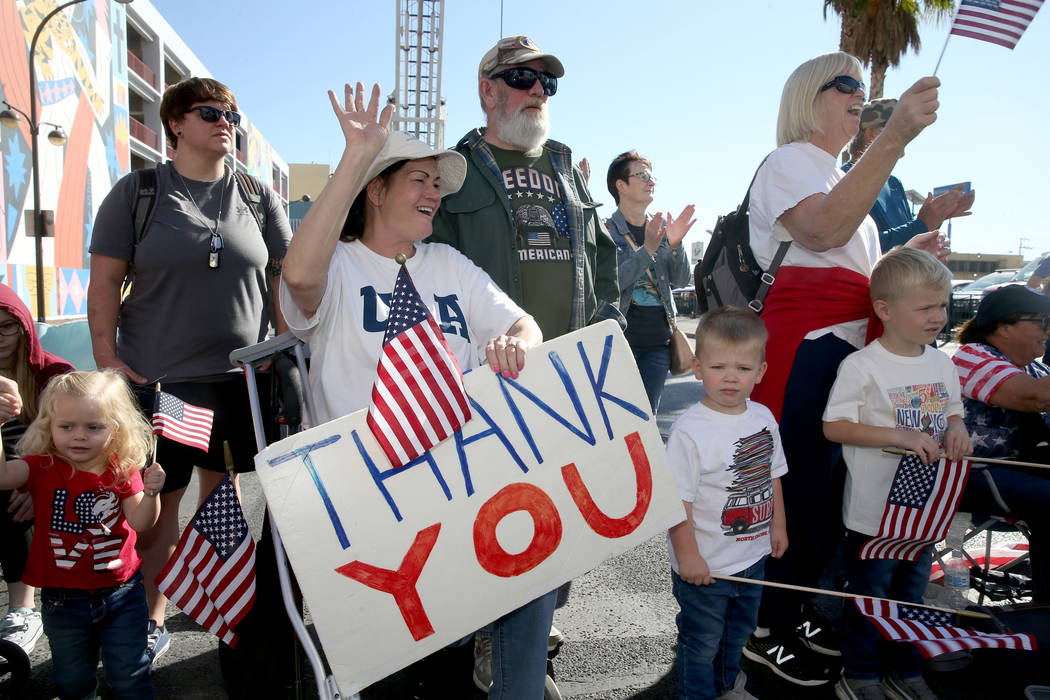 Shawn Wallice, 56, and her husband Ron Wallice, 67, of Las Vegas thanks veterans in the Veteran ...