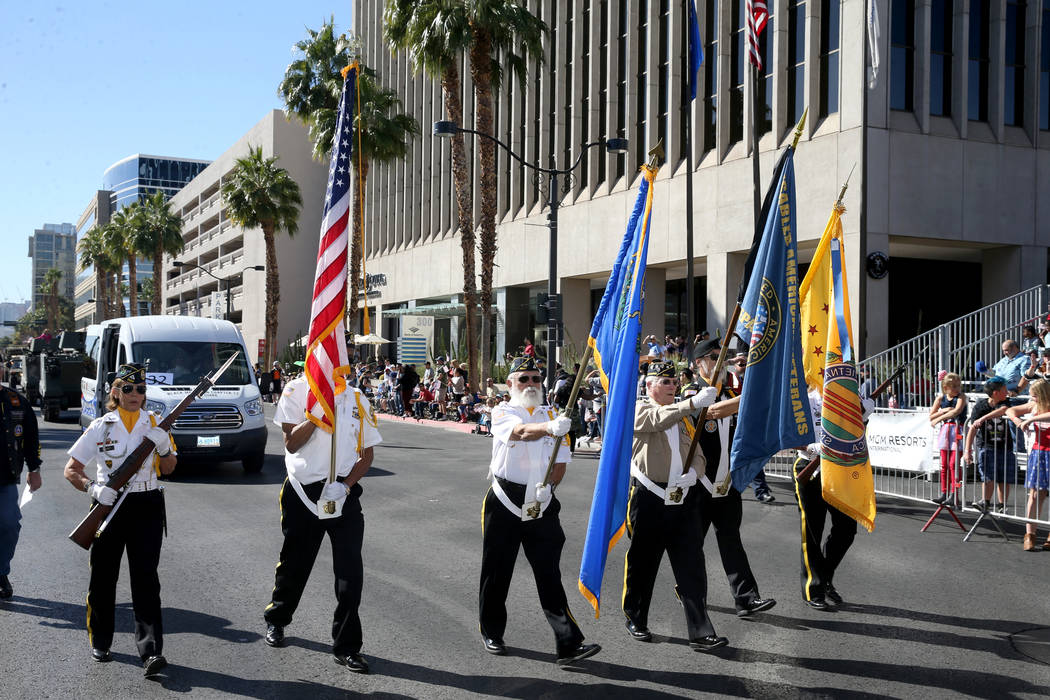 A color guard during the Veterans Day Parade in downtown Las Vegas Monday, Nov. 11, 2019. (K.M. ...