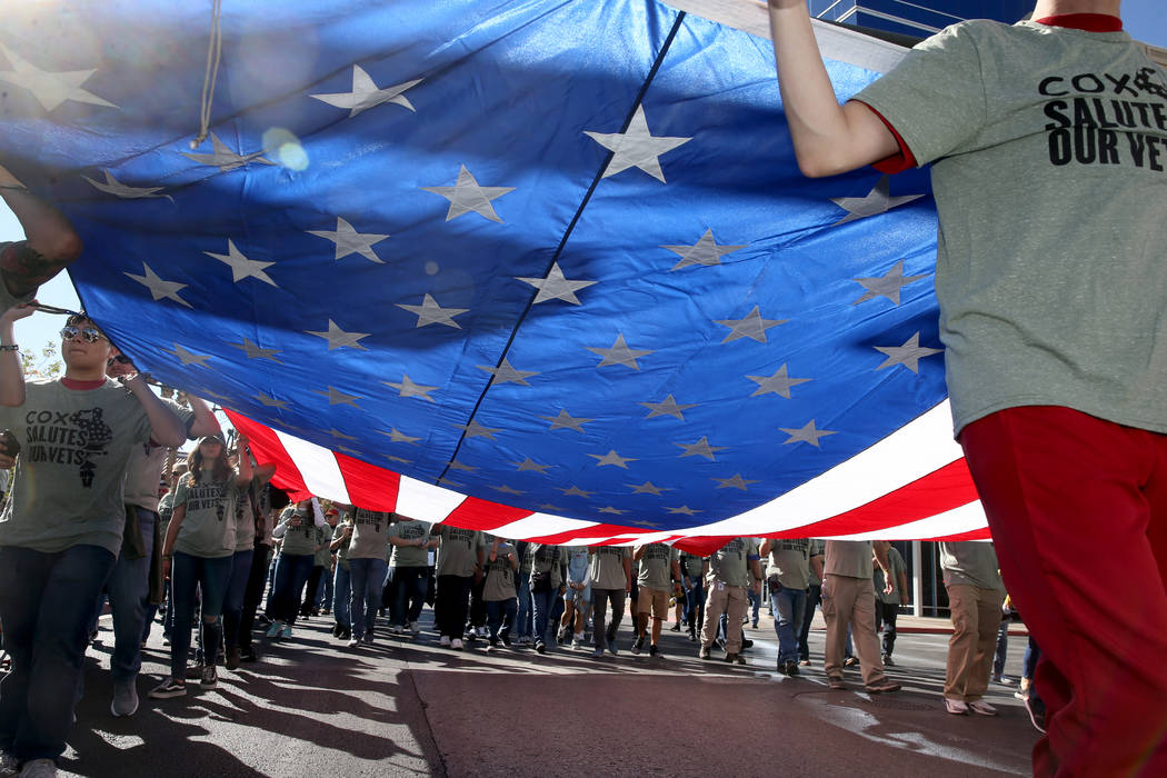 The Cox Communications entry in the Veterans Day Parade in downtown Las Vegas Monday, Nov. 11, ...