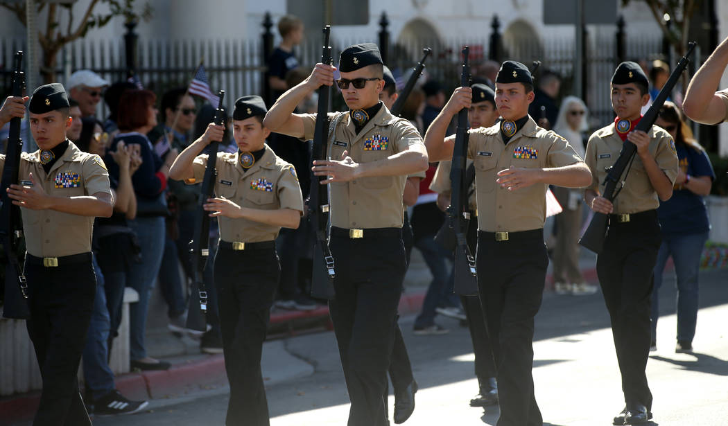 Centennial High School Navy Junior ROTC marches in the Veterans Day Parade in downtown Las Vega ...