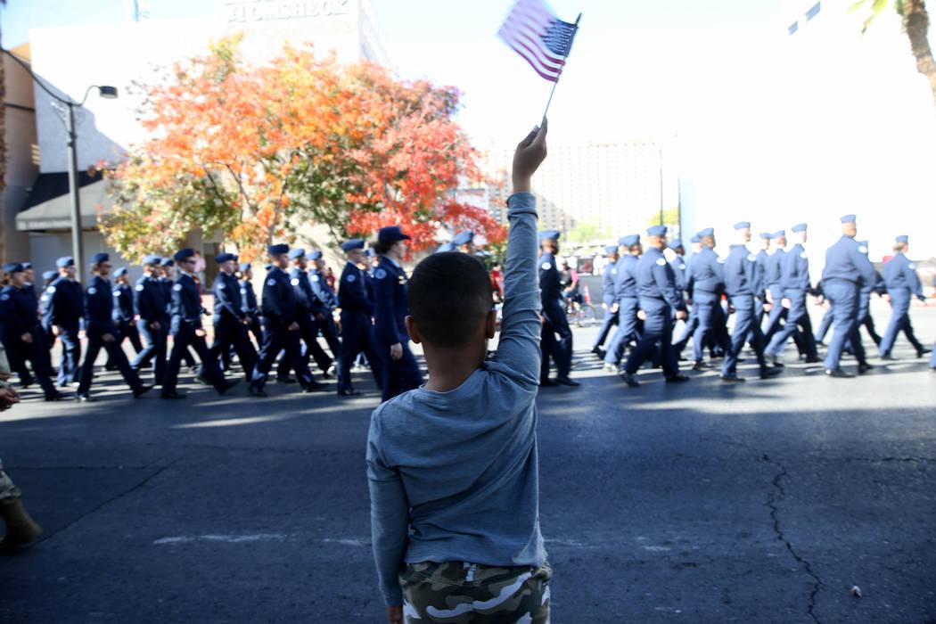 Matthew Goins, 6, of Las Vegas watches the Veterans Day Parade in downtown Las Vegas Monday, No ...