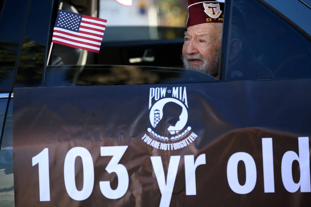 U.S. Army Air Corp veteran and Ex-POW Vince Shank, 103, in the Veterans Day Parade in downtown ...
