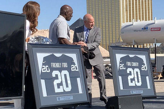 Raiders President Marc Badain, right, is joined former Raiders lineman Reggie Kinlaw and member ...
