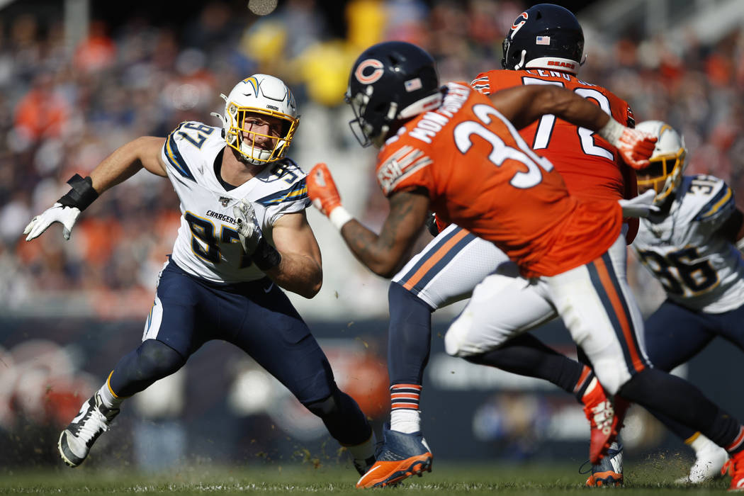 Los Angeles Chargers defensive end Joey Bosa (97) rushes in against the Chicago Bears during an ...