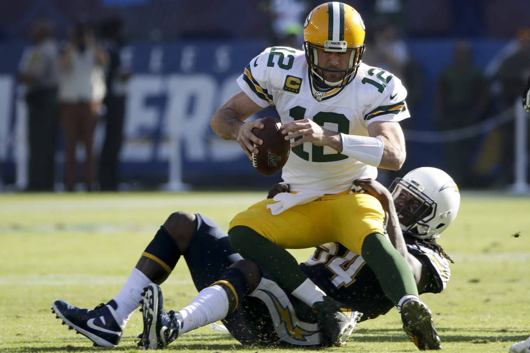 Green Bay Packers quarterback Aaron Rodgers is sacked by Los Angeles Chargers defensive end Mel ...