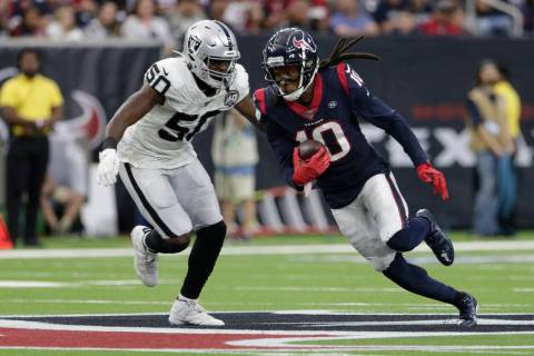 Houston Texans wide receiver DeAndre Hopkins (10) runs around Oakland Raiders linebacker Nichol ...