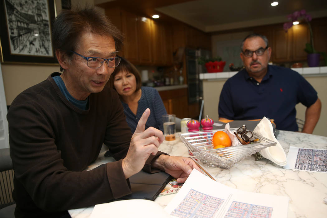 Wayne Niimi, from left, with his wife Lori, at the home of their neighbor Victor Padron, talk a ...