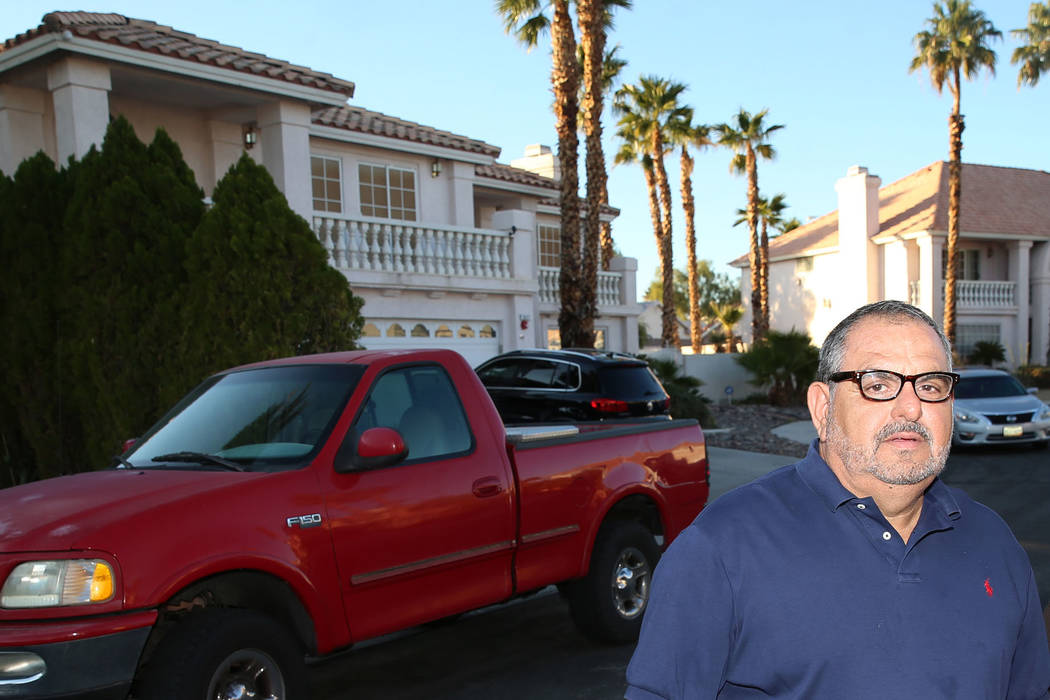 Victor Padron stands in front of his home in Las Vegas, Thursday, Nov. 7, 2019. Padron is conc ...