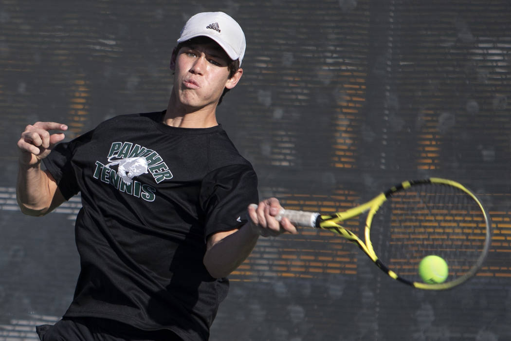 Palo Verde singles player Michael Andre hits the ball while playing Coronado's Tanner Phillips ...