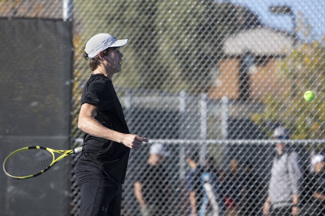 Palo Verde singles player Michael Andre jumps to hit the ball while playing Coronado's Tanner P ...