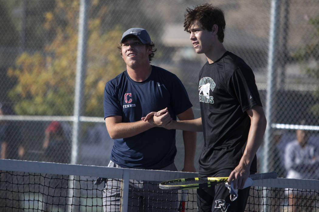 Palo Verde singles player Michael Andre shakes hands with Coronado's Tanner Phillips after winn ...