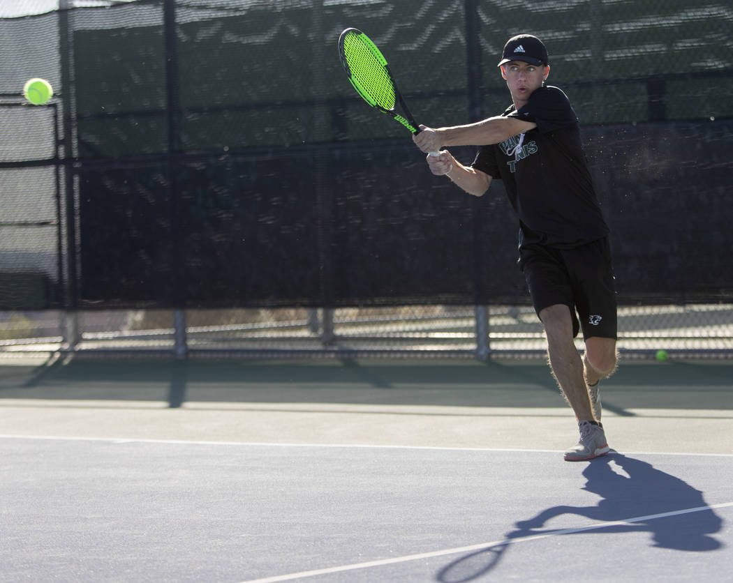Palo Verde's Jack Kostrinsky whacks the ball to Coronado's Aiden Benoualid during a singles mat ...