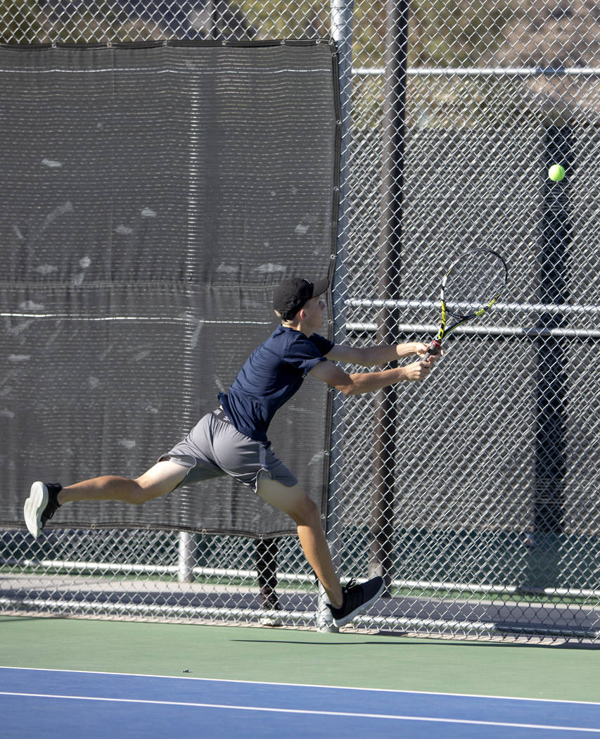 Coronado High School's Jonah Blake reaches for the ball during a doubles match with his partner ...