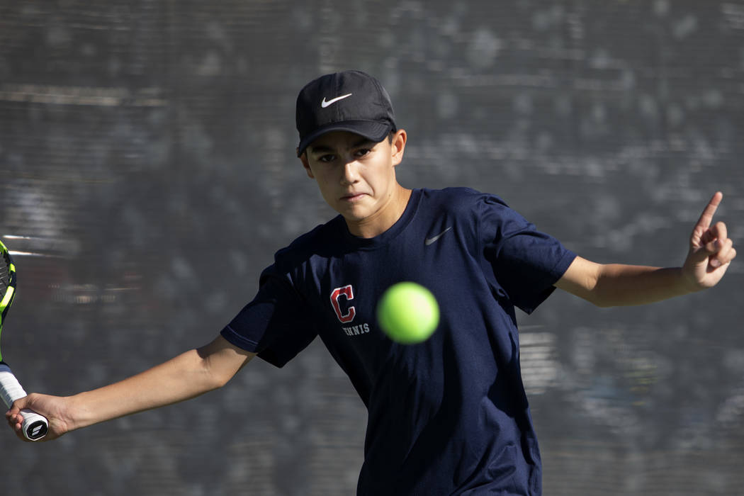 Coronado's Jack Wohlwend eyes the ball during a doubles match against Palo Verde High School on ...
