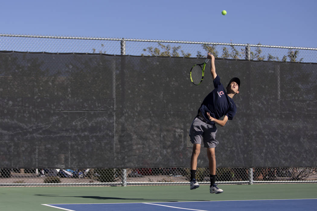 Coronado's Jack Wohlwend serves during a doubles match against Palo Verde High School on Wednes ...