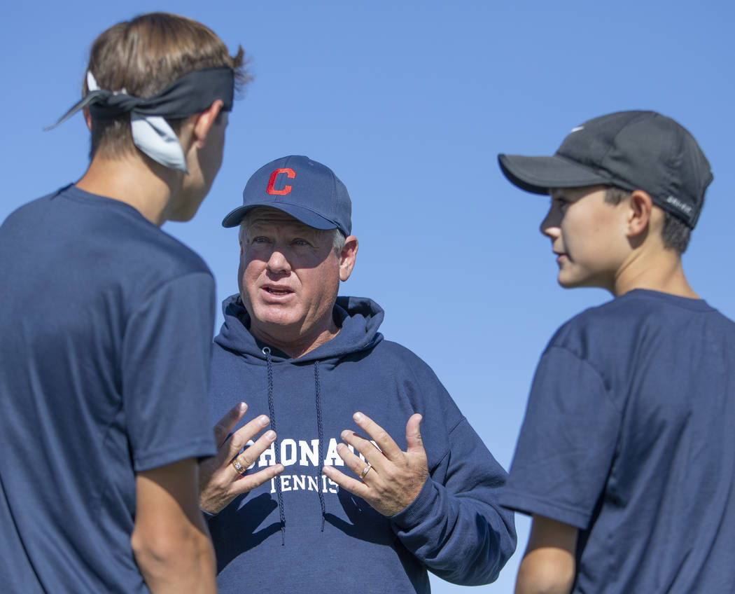 Coronado Head Coach David Willingham speaks to players Ian Hawkes and Jack Wohlwend during thei ...