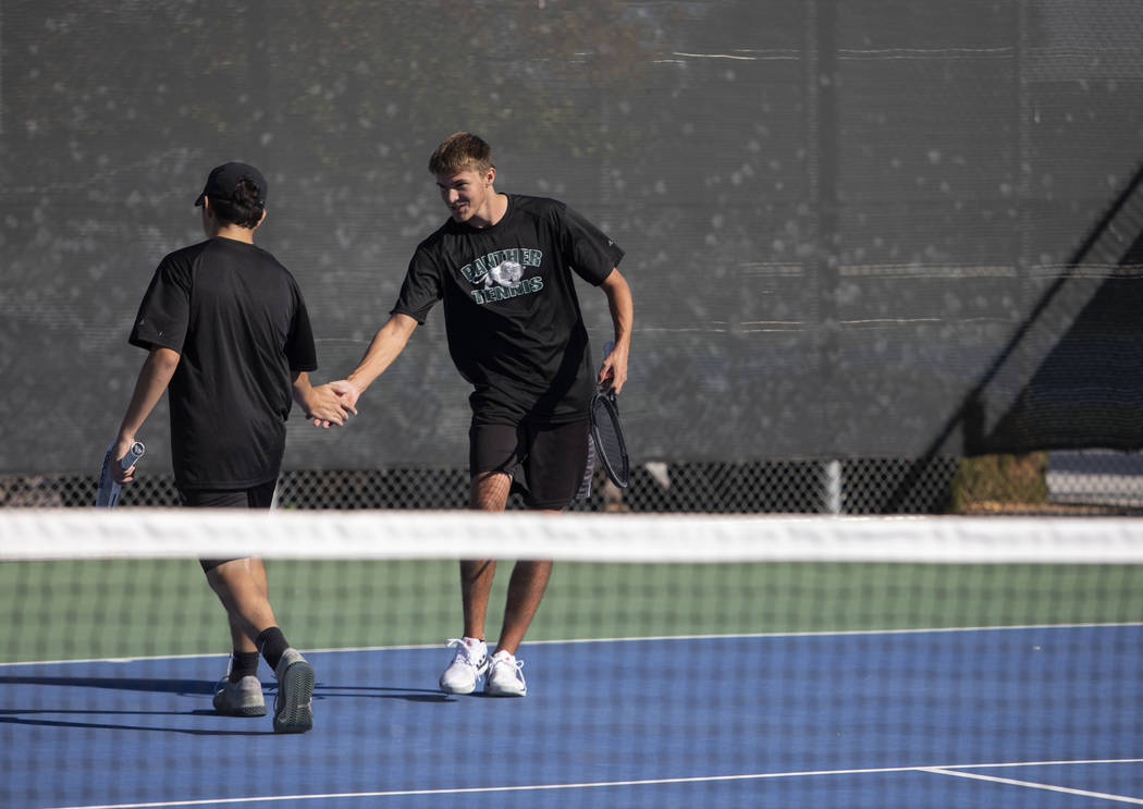 Palo Verde doubles partners Ryan Jensen, left, and Tyler Juhasz right, high five after earning ...